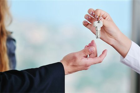 simsearch:400-05936191,k - man and woman hand closeup with home keys representing buying and selling new apartment and real estate concept Stock Photo - Budget Royalty-Free & Subscription, Code: 400-05181080