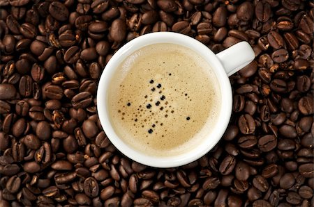 Image of a Cappuccino on coffee beans Stock Photo - Budget Royalty-Free & Subscription, Code: 400-05199874