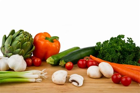 Image of a wood cutting board with assorted vegetables on a white background Stock Photo - Budget Royalty-Free & Subscription, Code: 400-05199876