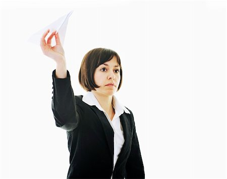 happy young business woman isolated ona white throwing paper airplane Stock Photo - Budget Royalty-Free & Subscription, Code: 400-05204424