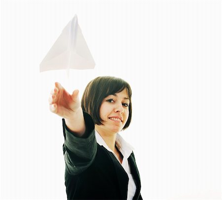 happy young business woman isolated ona white throwing paper airplane Stock Photo - Budget Royalty-Free & Subscription, Code: 400-05204425