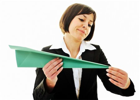 happy young business woman isolated ona white throwing paper airplane Stock Photo - Budget Royalty-Free & Subscription, Code: 400-05204427