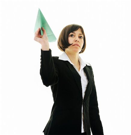 happy young business woman isolated ona white throwing paper airplane Stock Photo - Budget Royalty-Free & Subscription, Code: 400-05204429