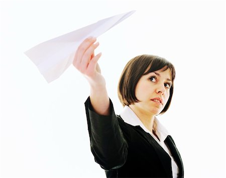 happy young business woman isolated ona white throwing paper airplane Stock Photo - Budget Royalty-Free & Subscription, Code: 400-05204423
