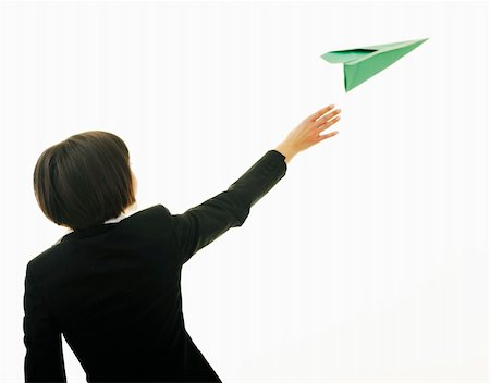 happy young business woman isolated ona white throwing paper airplane Stock Photo - Budget Royalty-Free & Subscription, Code: 400-05204434