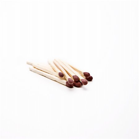 Matches unlit on a white surface Stock Photo - Budget Royalty-Free & Subscription, Code: 400-05206364