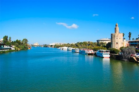 puentes - A view of the Guadalquivir River and the Torre del Oro, in Seville, Spain Stock Photo - Budget Royalty-Free & Subscription, Code: 400-05218421
