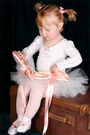 Little ballet toddler wearing a white tutu Stock Photo - Budget Royalty-Free & Subscription, Code: 400-05210410