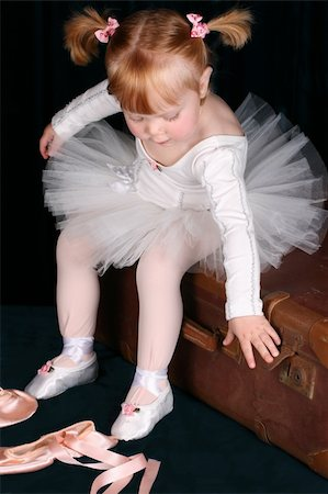 Little ballet toddler wearing a white tutu Stock Photo - Budget Royalty-Free & Subscription, Code: 400-05210412