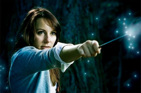 enemy - Teenage wizard girl with magic wand casting spells in a enchanted fantasy forest Stock Photo - Budget Royalty-Free & Subscription, Code: 400-05211630