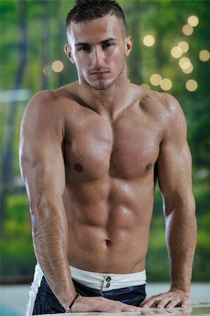 young healthy good looking macho man model athlete at hotel indoor pool Stock Photo - Budget Royalty-Free & Subscription, Code: 400-05224527