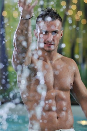 young healthy good looking macho man model athlete at hotel indoor pool Stock Photo - Budget Royalty-Free & Subscription, Code: 400-05224521