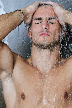 young good looking and attractive man with muscular body wet taking showr in bath with black tiles in background Stock Photo - Budget Royalty-Free & Subscription, Code: 400-05224539