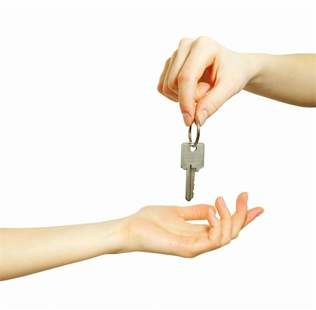 simsearch:400-05936191,k - hand holds a key isolated on white Stock Photo - Budget Royalty-Free & Subscription, Code: 400-05220475