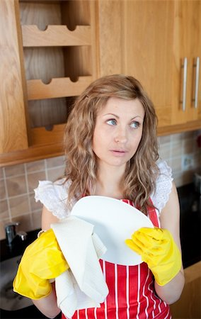 rubber apron woman - Attractive young woman drying dishes in the kitchen Stock Photo - Budget Royalty-Free & Subscription, Code: 400-05236480