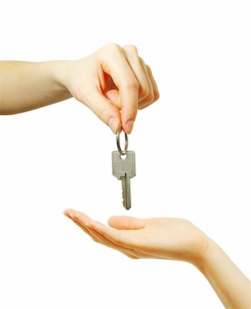 simsearch:400-05936191,k - hand holds a key isolated on white Stock Photo - Budget Royalty-Free & Subscription, Code: 400-05244075