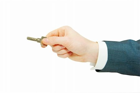 simsearch:400-05936191,k - hand holds a key isolated on white Stock Photo - Budget Royalty-Free & Subscription, Code: 400-05244116