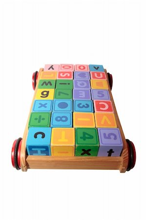 childrens toy letter building blocks all together in a toy cart isolated on white background with clipping path Stock Photo - Budget Royalty-Free & Subscription, Code: 400-05246304