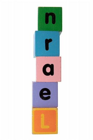assorted childrens toy letter building blocks against a white background that spell learn with clipping path Stock Photo - Budget Royalty-Free & Subscription, Code: 400-05246306