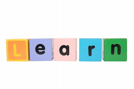 assorted childrens toy letter building blocks against a white background that spell learn with clipping path Stock Photo - Budget Royalty-Free & Subscription, Code: 400-05246307