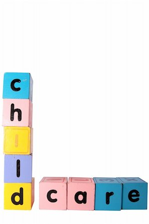 assorted childrens toy letter building blocks against a white background that spell childcare with clipping path Stock Photo - Budget Royalty-Free & Subscription, Code: 400-05246303