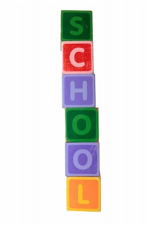 assorted childrens toy letter building blocks against a white background that spell school with clipping path Stock Photo - Budget Royalty-Free & Subscription, Code: 400-05246311