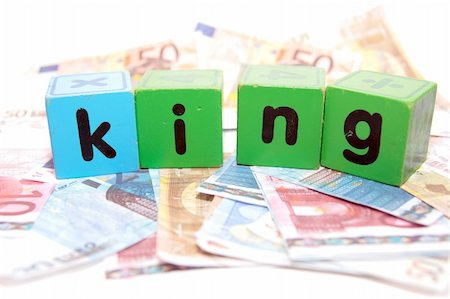 assorted childrens toy letter building blocks against a white background on money that spell king Stock Photo - Budget Royalty-Free & Subscription, Code: 400-05241320