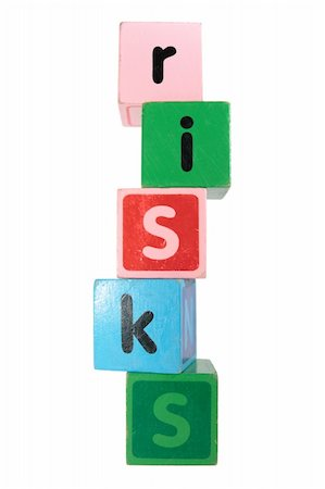 assorted childrens toy letter building blocks against a white background that spell risks Stock Photo - Budget Royalty-Free & Subscription, Code: 400-05241321
