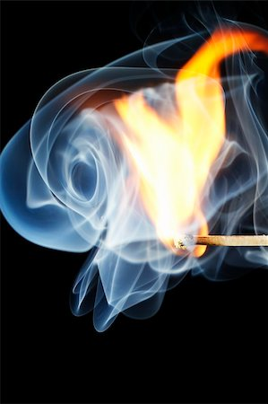one match is igniting in front of black background with blue smoke Stock Photo - Budget Royalty-Free & Subscription, Code: 400-05241989