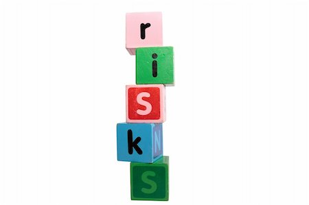risks spelt with childrens toy letter building blocks against a white background with clipping path Stock Photo - Budget Royalty-Free & Subscription, Code: 400-05242611