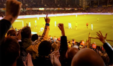 Fans excited at a football game, selective focus on fans with hands raised Stock Photo - Budget Royalty-Free & Subscription, Code: 400-05254170