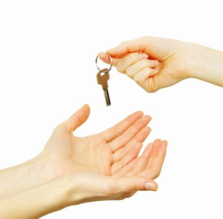 simsearch:400-05936191,k - hand holds a key isolated on white Stock Photo - Budget Royalty-Free & Subscription, Code: 400-05252852