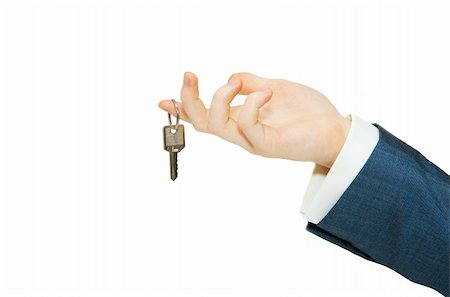 simsearch:400-05936191,k - hand holds a key isolated on white Stock Photo - Budget Royalty-Free & Subscription, Code: 400-05252869