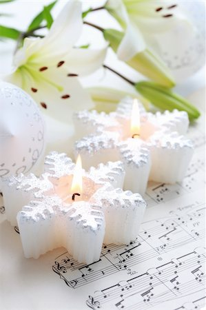 Christmas still life with candles and music notes Stock Photo - Budget Royalty-Free & Subscription, Code: 400-05261271