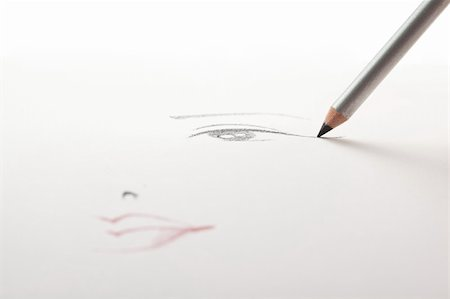 a make-up sketch, drawn on white paper, with a black eye liner pencil drawing the eye and the mouth in a blur. Stock Photo - Budget Royalty-Free & Subscription, Code: 400-05284770