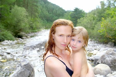 mother daughter playing in river after swimming outdoor nature Stock Photo - Budget Royalty-Free & Subscription, Code: 400-05286581
