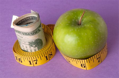 education loan - An apple, tape measure, and American currency represents the concept of measuring the cost of healthcare, food, or education.  Can also work for concept of the cost of healthcare, education or food. Stock Photo - Budget Royalty-Free & Subscription, Code: 400-05280675