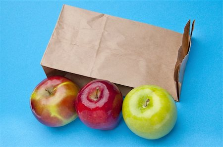 Healthy School Lunch Themed Image with Apples and a Brown Bag. Stock Photo - Budget Royalty-Free & Subscription, Code: 400-05281066