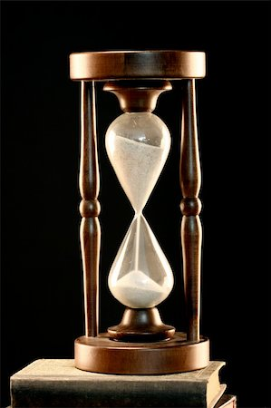 sand clock - Hourglass close up over black Stock Photo - Budget Royalty-Free & Subscription, Code: 400-05283212