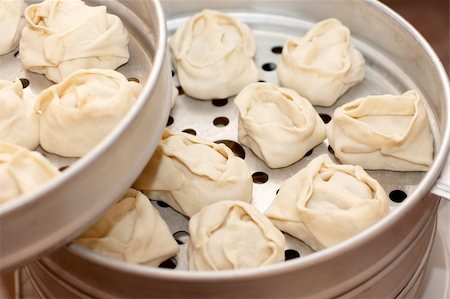 dumplings steamer - Metall steam cooker with oriental dumplings (manty) Stock Photo - Budget Royalty-Free & Subscription, Code: 400-05294157