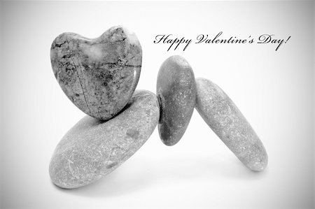 happy valentine's day written on a degraded background and a pile of stones heart-shapped Stock Photo - Budget Royalty-Free & Subscription, Code: 400-05294548