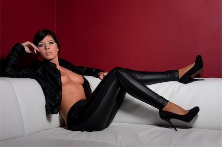 sexy brunette in leather at sofa Stock Photo - Budget Royalty-Free & Subscription, Code: 400-05296576
