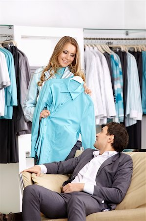 The girl shows to the man a shirt in shop Stock Photo - Budget Royalty-Free & Subscription, Code: 400-05291311