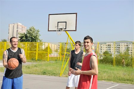 basketball player team group  posing on streetbal court at the city on early morning Stock Photo - Budget Royalty-Free & Subscription, Code: 400-05291628