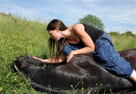 horse laid down and teen Stock Photo - Budget Royalty-Free & Subscription, Code: 400-05292062
