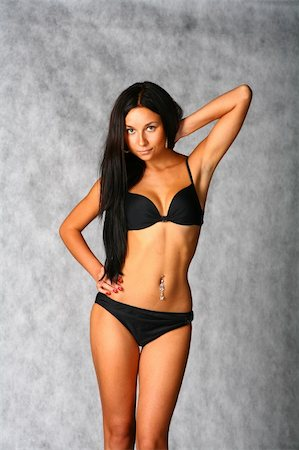 beautiful bikini girl isolated over a gray background Stock Photo - Budget Royalty-Free & Subscription, Code: 400-05306299