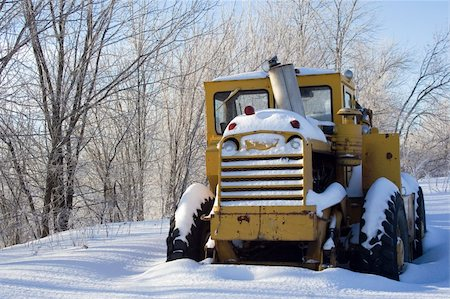 snow plow truck - Snow covered tractor abandoned Stock Photo - Budget Royalty-Free & Subscription, Code: 400-05306872