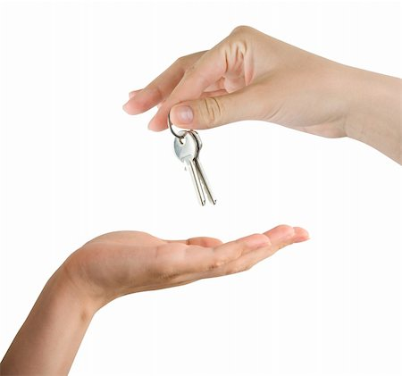 finger holding a key - Human hands and key isolated on white background Stock Photo - Budget Royalty-Free & Subscription, Code: 400-05306937