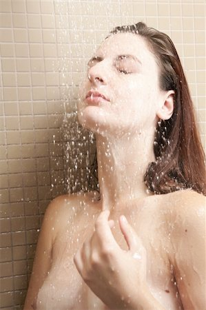 Sexy young adult Caucasian woman with long auburn hair and petite breasts taking a shower in a tile and glass modern bathroom. Stock Photo - Budget Royalty-Free & Subscription, Code: 400-05302546
