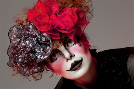 Woman mime with theatrical makeup. Studio shot. Stock Photo - Budget Royalty-Free & Subscription, Code: 400-05314766